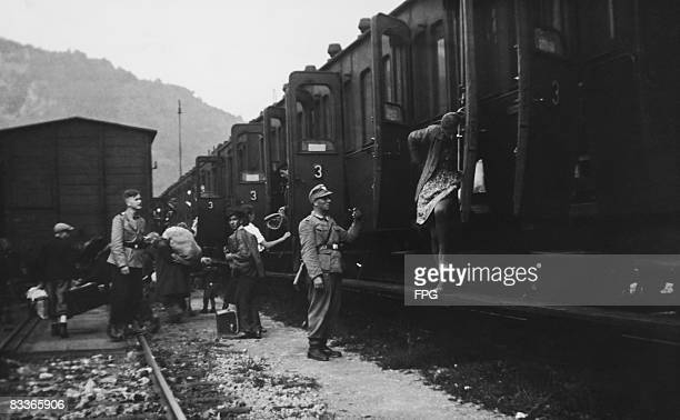 The children of partisan parents from Celje Yugoslavia arrive in Frohnleiten Austria where they are met by German military police officers August...