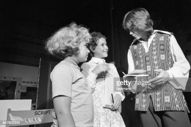The children of Presidential adviser, Henry Kissinger, Elizabeth and David are shown as they received the autograph of singer-actor David Cassidy....