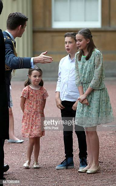 The children of Samantha and David Cameron Nancy Elwen and Florence are greeted as they arrive at Buckingham Palace where their father will have an...
