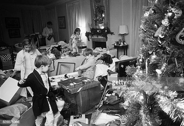 The children of Senator Robert F Kennedy and Ethel Kennedy open presents on Christmas day Hickory Hill McLean Virginia December 25 1967