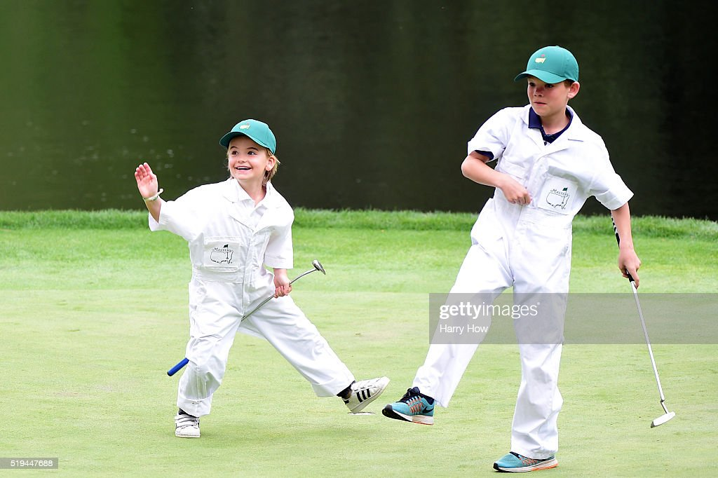 The children of Soren Kjeldsen of Denmark play on the ninth green during the Par 3 Contest prior to the start of the 2016 Masters Tournament at Augusta National Golf Club on April 6, 2016 in Augusta, Georgia.