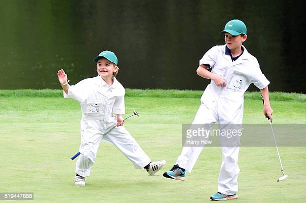 The children of Soren Kjeldsen of Denmark play on the ninth green during the Par 3 Contest prior to the start of the 2016 Masters Tournament at...