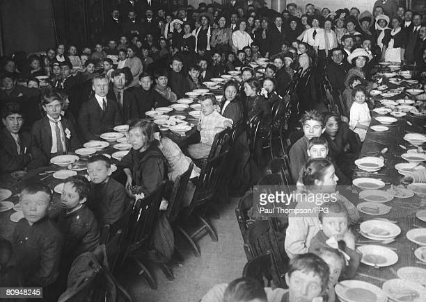 The children of striking workers in Lawrence Massachusetts are provided with food at the Labor Temple in New York City during the Lawrence Textile...