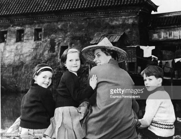 The children of Swedishborn actress and Italian director Roberto Rosssellini sit with their mother and turn back to the camera as they visit her on...