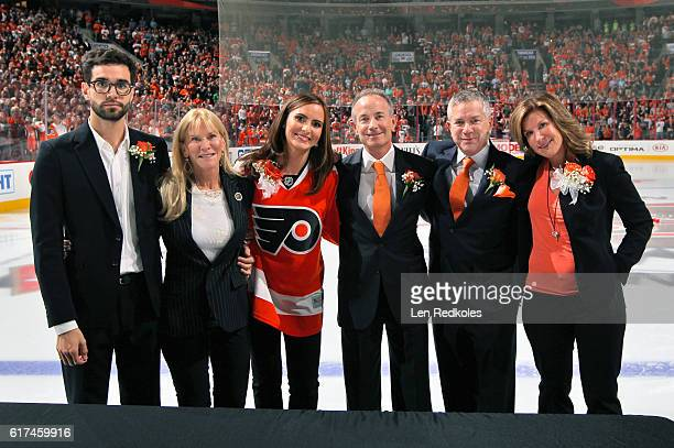 The children of the late owner Ed Snider Samuel Lindy Sarena Jay Craig and Tina pose for a photo during the pregame opening night ceremonies prior to...
