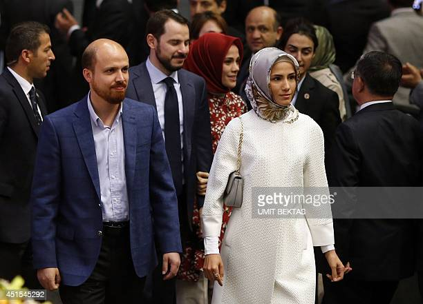 The children of the Turkish prime minister Bilal Sumeyye and Esra and soninlaw Berat Albayrak attend a ceremony in Ankara on July 1 2014 for the...