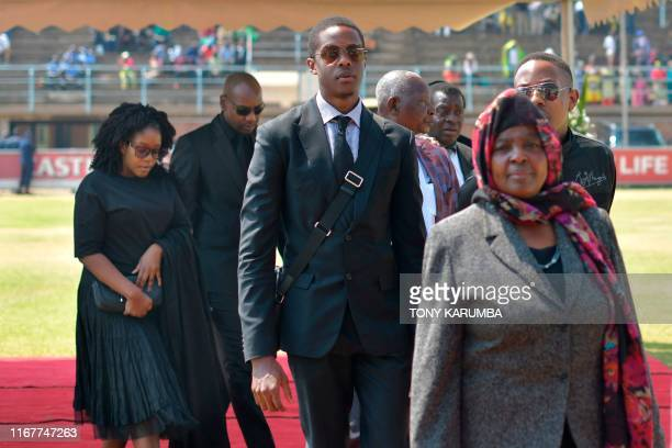 The children of Zimbabwe's former President the late Robert Mugabe Robert Junior Chatunga and Bona arrive at Rufaro stadium on September 13 2019...