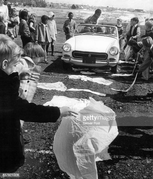 The Children spread cloth as symbols of palm branches used by those who greeted Jesus when He rode into the city on a donkey Palm Sunday Driving auto...
