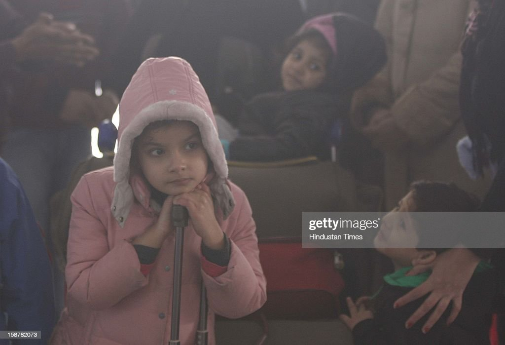The children take precautions against the Cold and foggy Weather at Indira Gandhi International Airporton December 28, 2012 in New Delhi, India. While the maximum temperature was recorded at 19 deg C, up from yesterday's temperature by 2.4 degrees, the minimum temperature today dipped to 6.3 deg C, a degree below the normal.
