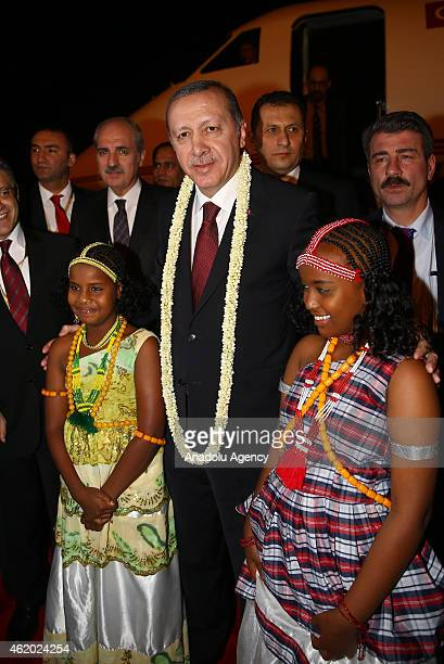 The children welcomes to Turkish President Recep Tayyip Erdogan at Ambouli airport in Djibouti on January 23 2015