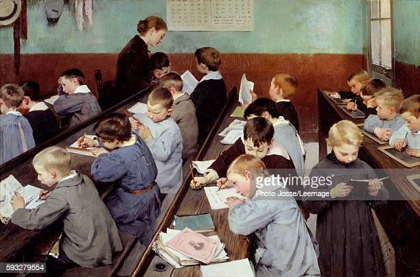 The Children's Class Young boys in smocks studying in a classroom some reading the other writing on their exercise books or on slates Painting by...