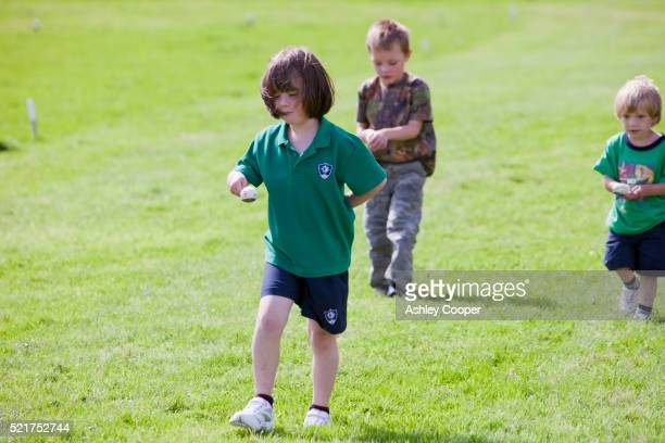 The childrens egg and spoon race at the Rusland Vale Horticultural society annual show. The Rusland show is a very traditional Lakeland family show in Rusland, South Cumbria, UK.