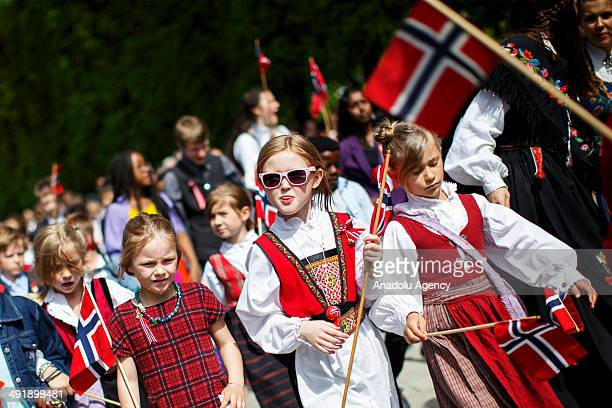 The children's parade goes through the streets of Oslo on Norwegian Constitution Day on May 17 2014 in Oslo Norway Norway's Constitution declaring...