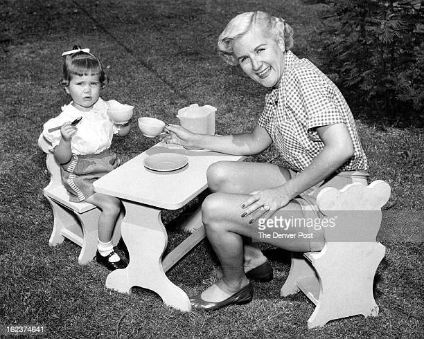 The child's table and chair set, displayed above by Songstress Margaret Whiting and her little girl, is a junior edition of a grown-up's model. It...
