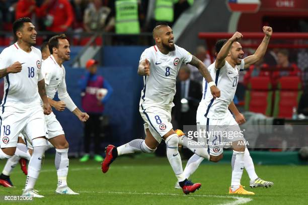 The Chile players celebrate after winning a penalty shootout during the FIFA Confederations Cup Russia 2017 SemiFinal match between Portugal and...