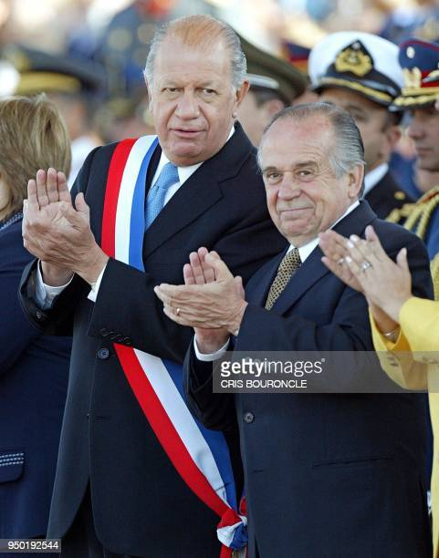 The Chilean President Ricardo Lagos and the president of the senate Andres Zaldivar applaud while the troops march during a military parade in...