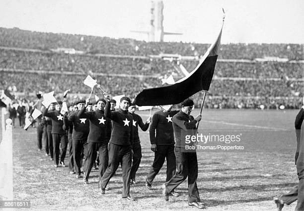 The Chilean team parade around the ground during the ceremony to open the Estadio Centenario in Montevideo prior to the FIFA World Cup match between...