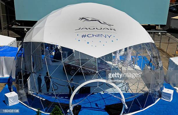 The Chill NY Experience lifesize snow globe stands during the 2013 Jaguar model year lineup introduction in New York US on Thursday Aug 16 2012 Tata...