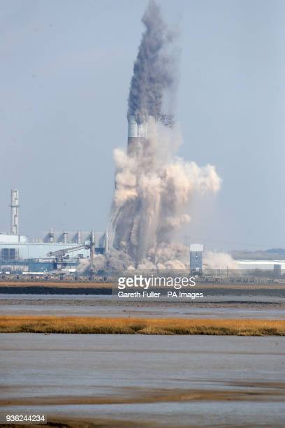 The chimney stack at Uniper's decommissioned Kingsnorth Power Station in Hoo Rochester Kent which stands at twice the height of Big Ben is demolished...