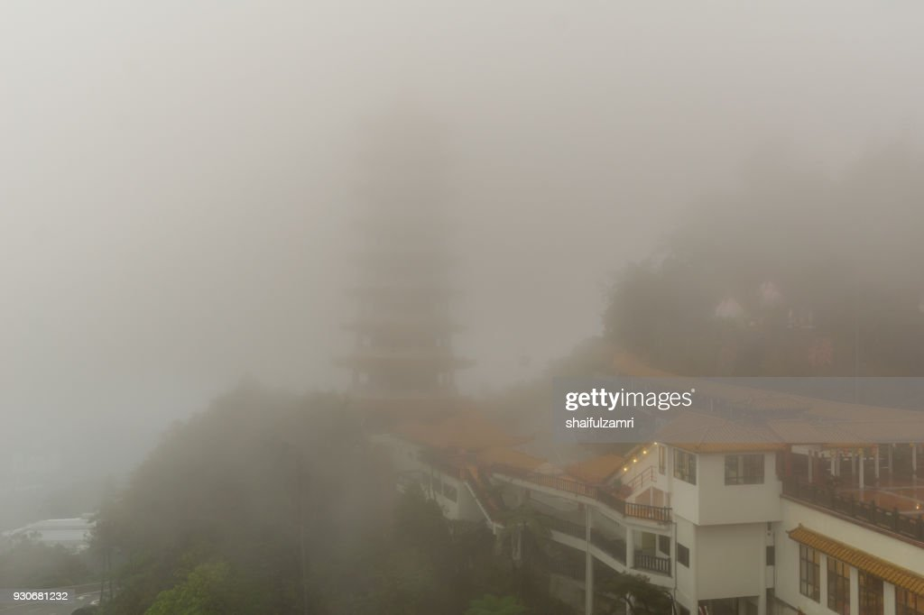 The Chin Swee Caves Temple over clouds and heavy fog. The temple is situated in the most scenic site of Genting Highlands, Malaysia. Within the Temple is seated a statue of Qingshui, a Buddhist monk who has long been referred to as a deity. : Stock Photo
