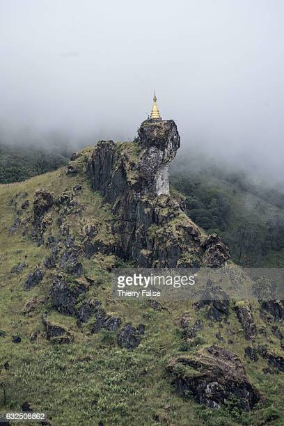 The Chin Thay Taung pagoda stands in the mist in the Mogok valley