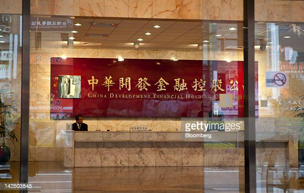 The China Development Financial Holding Co. Logo is displayed on the wall inside the reception area at the company's headquarters in Taipei, Taiwan,...