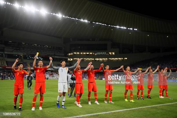 The China players celebrate at the end of the AFC Asian Cup round of 16 match between Thailand and China at Hazza Bin Zayed Stadium on January 20,...