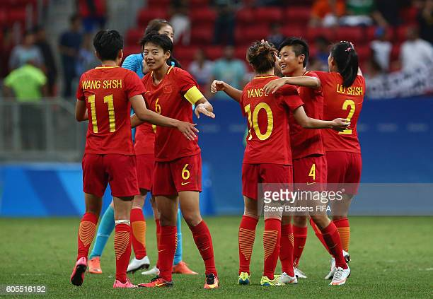 The China PR players celebrate drawing 00 with Sweden after the Women's First Round Group E match between China PR and Sweden on Day 4 of the Rio...