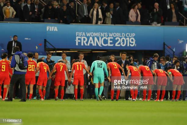 The China team bow to the head coach / manager of China Jia Xiuquan after victory during the 2019 FIFA Women's World Cup France group B match between...