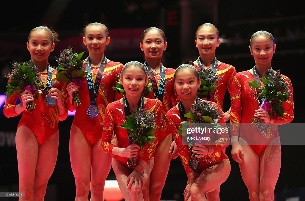 The China team celebrate winning Silver after Day 5 of the 2015 World Artistic Gymnastics Championships at The SSE Hydro on October 27, 2015 in Glasgow, Scotland.