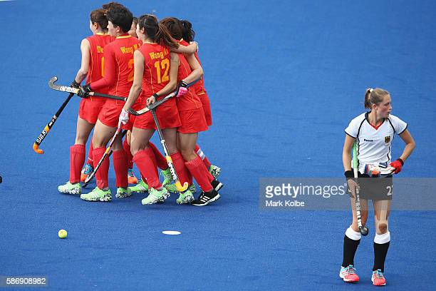 The China team celebrate with Yang Peng of China after she scored a goal during the women's pool A match between China and Germany on Day 2 of the...