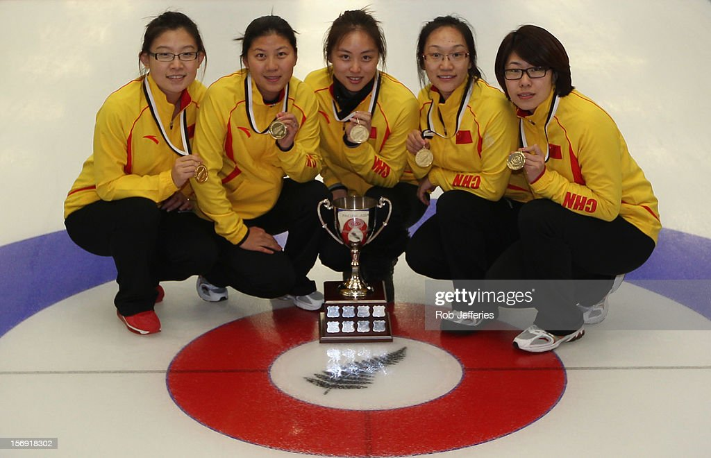 The China team of Bingyu Wang, Yin Liu, Qingshuang Yue, Yan Zhou and Jinli Liu pose for a photo during the Pacific Asia 2012 Curling Championship at the Naseby Indoor Curling Arena on November 25, 2012 in Naseby, New Zealand.