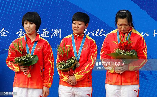 The China team pose with the bronze medals won in the Women's 10m Air Pistol Team competition at the Aoti Shooting Range during day two of the 16th...