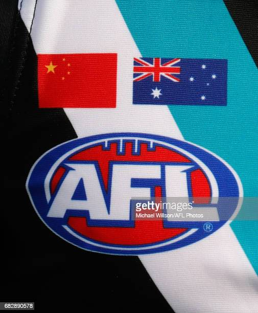 The Chinese and Australian flags are seen on the Port Adelaide guernsey during the 2017 AFL round 08 match between the Gold Coast Suns and Port...