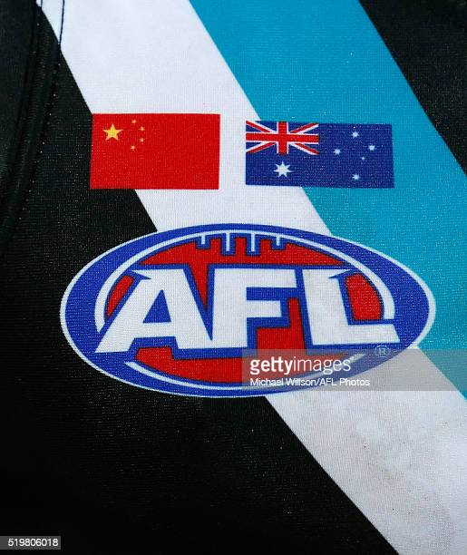 The Chinese and Australian flags are seen on the Power jumper after the match was broadcast live into China during the 2016 AFL Round 03 match...