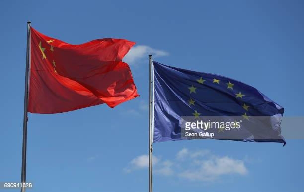The Chinese and European Union flags fly prior to the arrival of Chinese Prime Minister Li Keqiang at the Chancellery on May 31, 2017 in Berlin,...