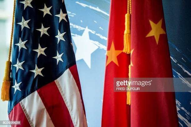 The Chinese and US national flags are seen during a promotional event in Beijing on June 30 2017