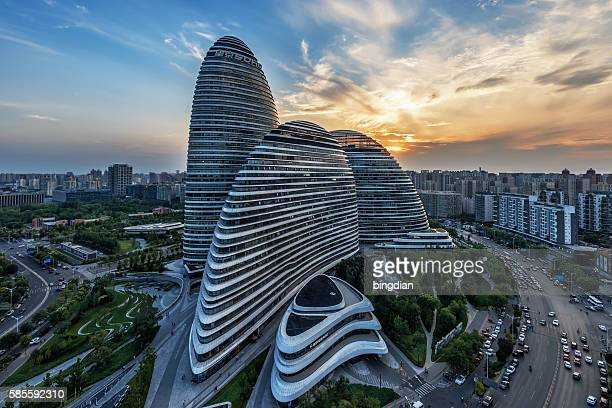 the chinese city and the famous landmark building, wangjing soho's night. - soho new york stock photos and pictures