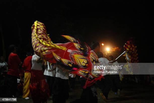 The Chinese Dragon dance performs during the Vesak Day 2559 BE ceremony at Maha Vihara Mojopahit Trowulan on June 2 2015 in Mojokerto Indonesia...