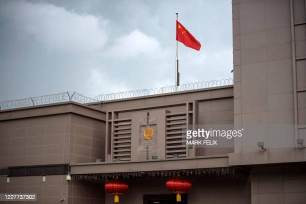 The Chinese flag flies at the Chinese consulate in Houston on July 22, 2020. - US-Chinese tensions, already rising because of the coronavirus...