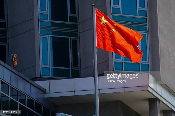The Chinese flag flies outside the Chinese consulate.