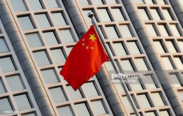 The Chinese flag flies outside the Foreign Ministry headquarters in Beijing on December 12 2011 China's top leaders opened a threeday meeting to set...