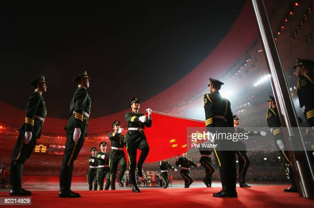 The Chinese flag is carried by the military during the Opening Ceremony for the 2008 Beijing Summer Olympics at the National Stadium on August 8,...