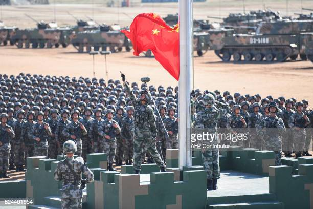The Chinese flag is raised during a military parade at the Zhurihe training base in China's northern Inner Mongolia region on July 30 2017 China held...