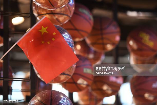 The Chinese flag is seen with a display of basketballs in the National Basketball Association store in Beijing on October 9 2019 Chinese state media...