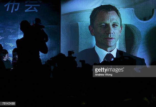 The Chinese media watch a trailer from the film during a news conference before the Chinese premiere of the new James Bond film 'Casino Royale' on...