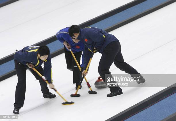 The Chinese men's curling team sweep their way down the ice against Korea at the Asian Winter Games in Changchun in China's northeast Jilin province...