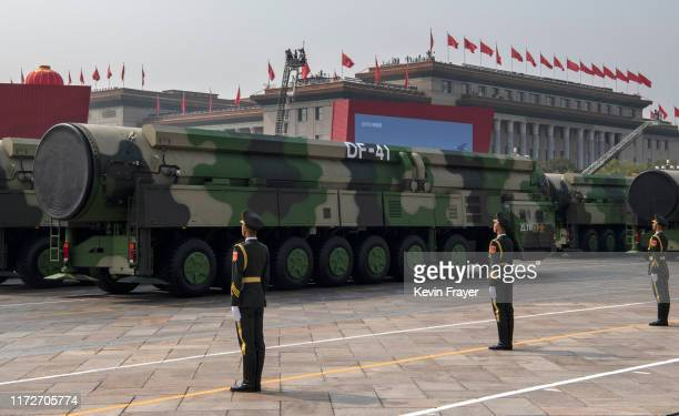 The Chinese military's new DF-41 intercontinental ballistic missiles, that can reportedly reach the United States, are seen at a parade to celebrate...