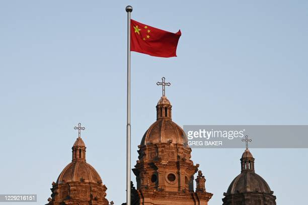 The Chinese national flag flies in front of St Joseph's Church, also known as Wangfujing Catholic Church, in Beijing on October 22 the day a...