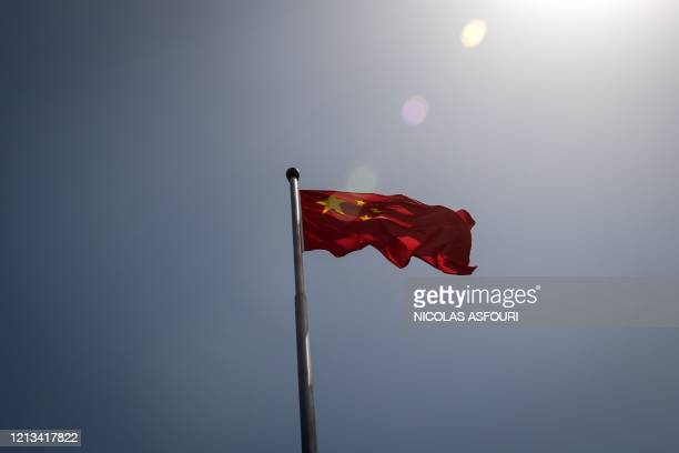 The Chinese national flag is seen at the entrance to the Zhongnanhai leadership compound in Beijing on May 18, 2020. - The annual meeting of the...